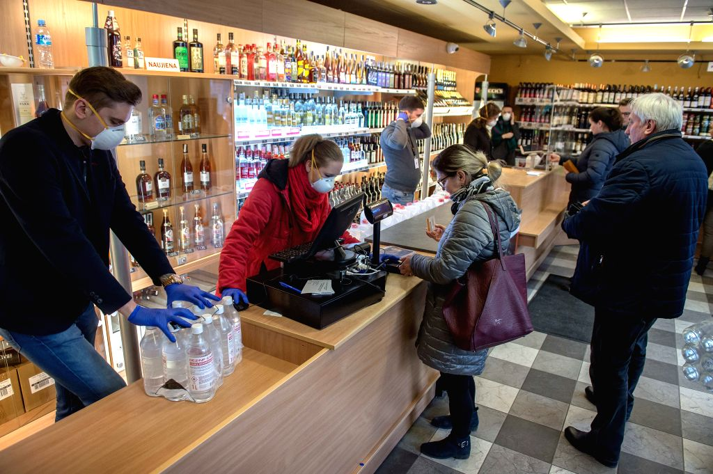 People buy disinfectant in a shop in Vilnius, Lithuania, on March 18, 2020. From March 16 until March 30, Lithuania is under a two-week national quarantine with ...