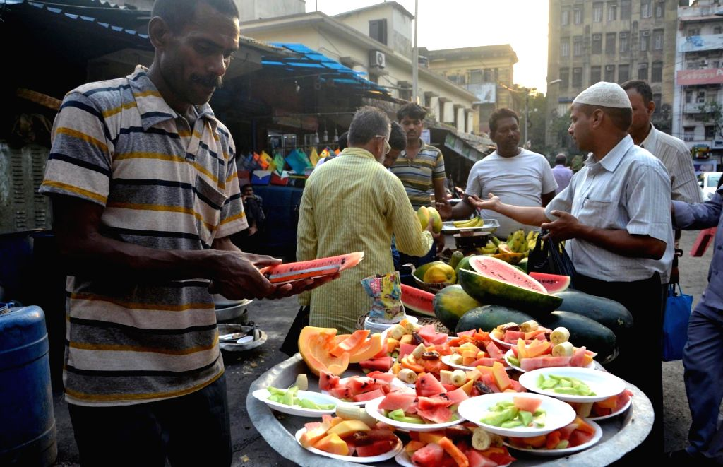 People buy fruits for iftaar during holy month of Ramadan, in Kolkata on May 18, 2018.