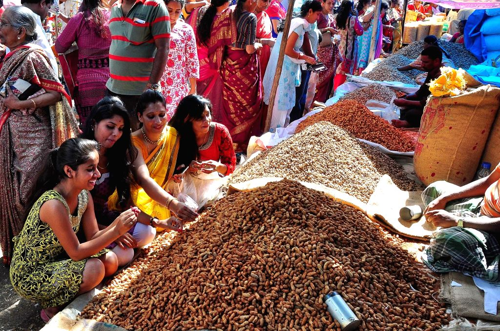 People buy groundnuts during Kadlekai Parishe (Groundnut festival) at the Bull Temple Road, Basavanagudi, in Bengaluru on Nov 28, 2016.