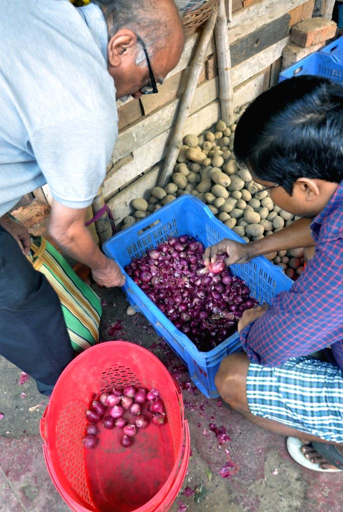 People buy onions at a subsidised rate of Rs 59 a Kg at Sufal Bangla vegetable market in Kolkata on Dec 6, 2019. Onion prices in the country are on a surge with the highest recorded at Rs ...