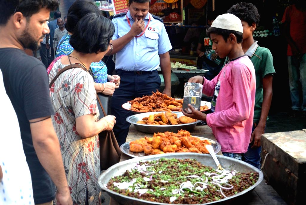 People buy snacks for iftaar during holy month of Ramadan, in Kolkata on May 18, 2018.