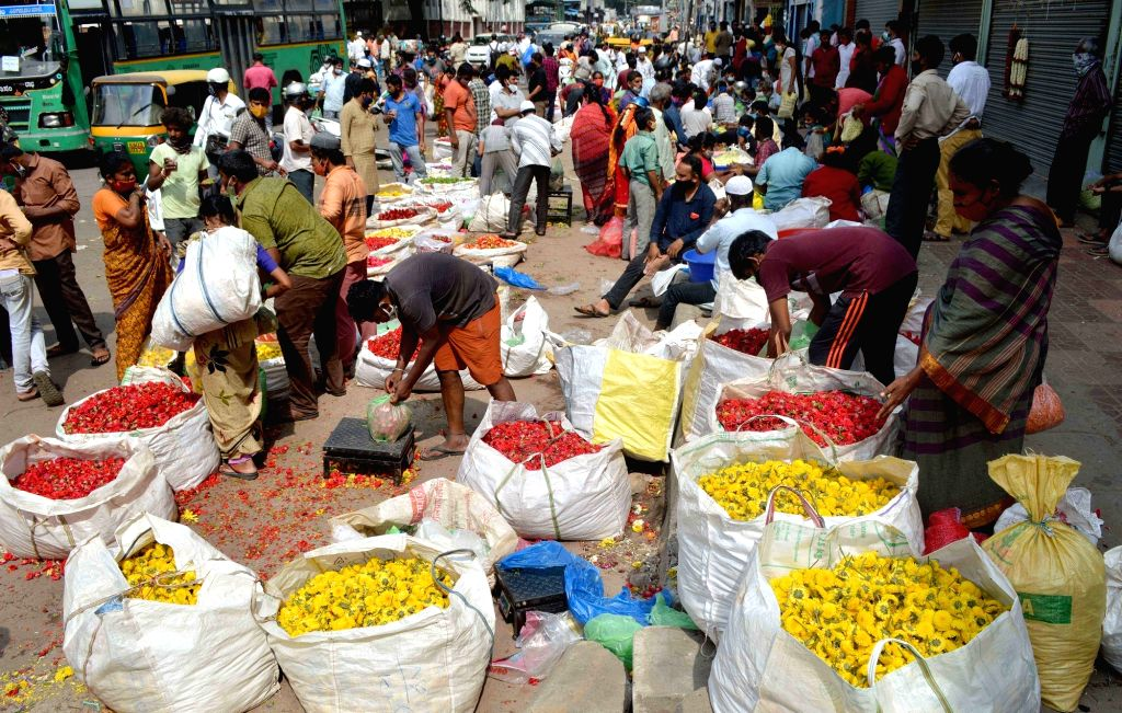 People buying vegetables near KR Market during lockdown in the wake of the 2nd wave of  COVID-19, in Bengaluru on Saturday, 8th May, 2021.