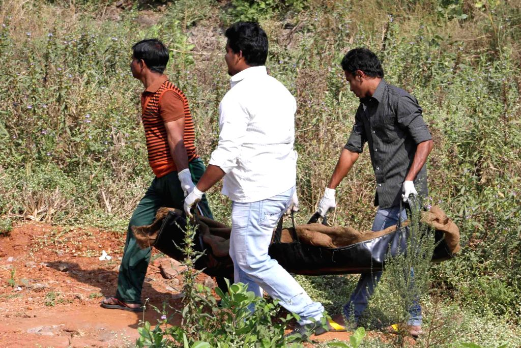 People carry bodies of the people who died in a chemical boiler tanker blast at Dombivali near Davdi naka in Thane district on on Dec.6, 2013. Four people were killed in the accident. (Photo: B L ...