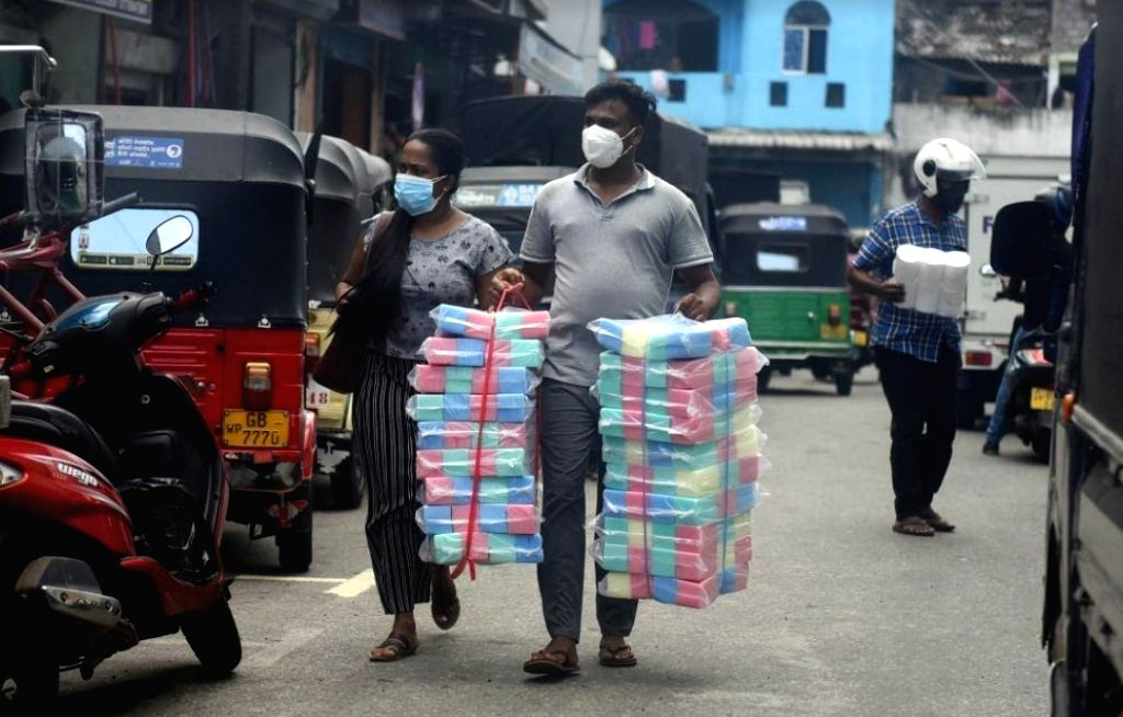 People carry goods at a market in Colombo, Sri Lanka, on June 21, 2021.