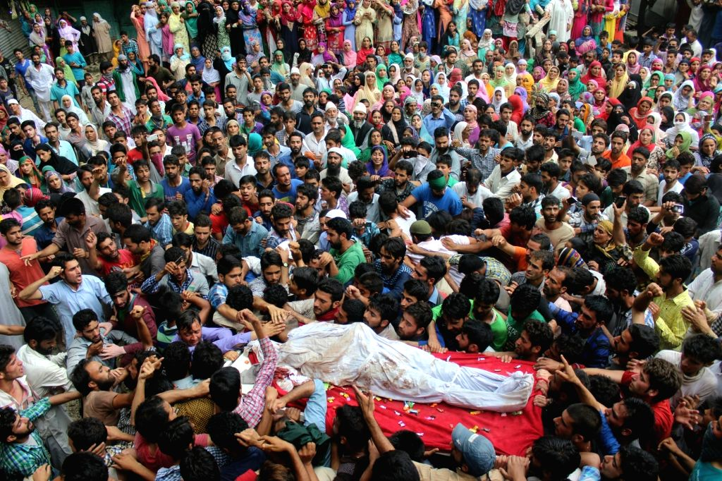 """People carry the body of Sameer Wani, identified as a """"top local Hizbul commander"""" by security personnel in Jammu and Kashmir's Kupwara district on June 28, 2016."""