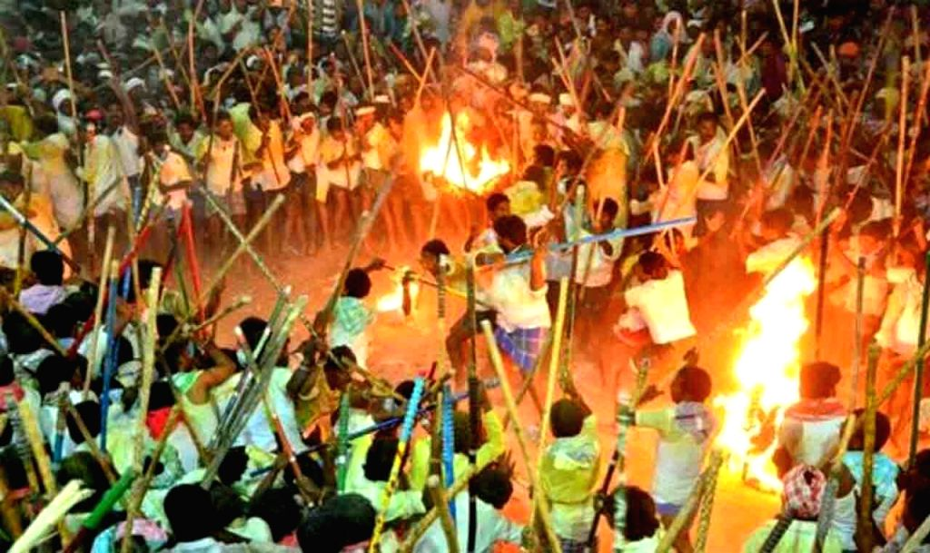 People carrying flames and long sticks, participate in annual stick fight ritual celebrated as 'Banni Festival' in Andhra Pradesh's Kurnool district, on Oct 8, 2019. Reportedly 50 people ...