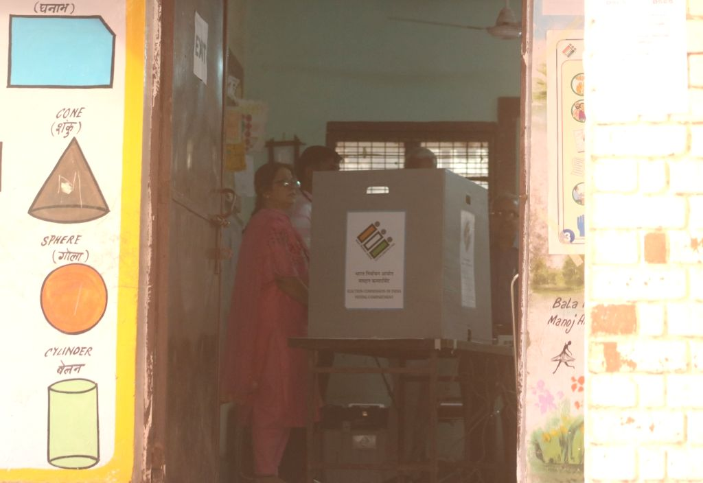 People cast their votes during the sixth phase of 2019 Lok Sabha elections at a polling booth in New Delhi on May 12, 2019.