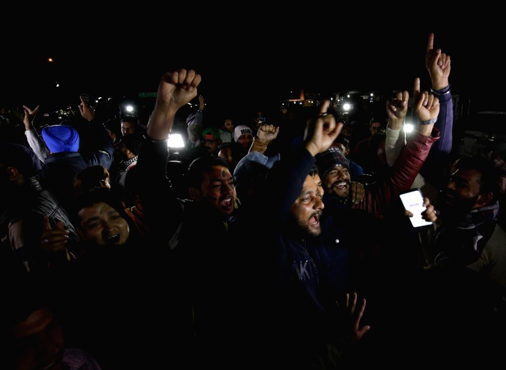 People celebrate as 35-year-old IAF Wing Commander Abhinandan Varthaman returns back to India; in Attari, Punjab on March 1, 2019. He was captured on Wednesday by Pakistan after his MiG-21 ...