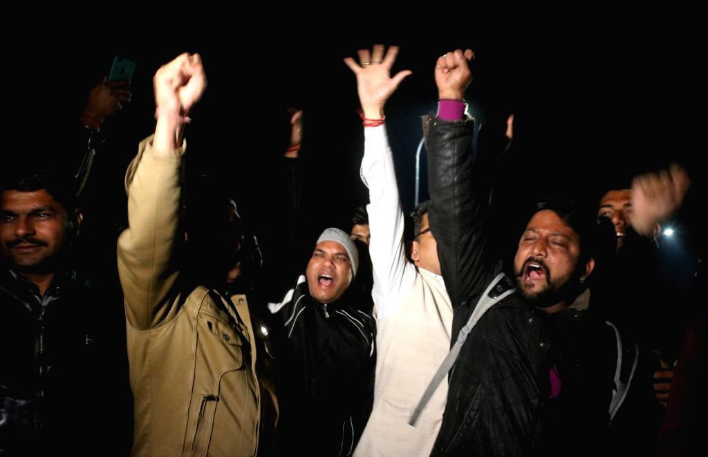 People celebrate as 35-year-old IAF Wing Commander Abhinandan Varthaman returns back to India; in New Delhi on March 1, 2019. He was captured on Wednesday by Pakistan after his MiG-21 ...