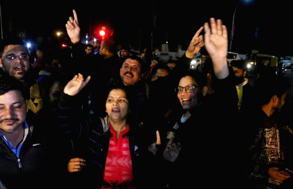 People celebrate as 35-year-old IAF Wing Commander Abhinandan Varthaman arrives in New Delhi on March 1, 2019. He was captured on Wednesday by Pakistan after his MiG-21 Bison fighter jet ...