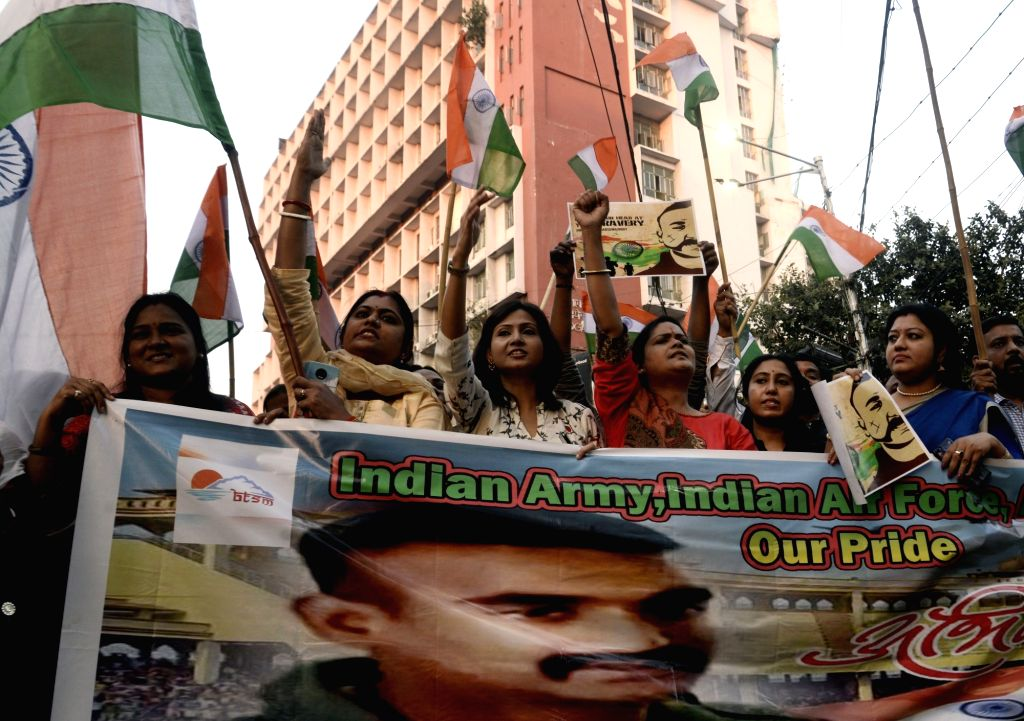 People celebrate as 35-year-old IAF Wing Commander Abhinandan Varthaman returns back to India; in Kolkata on March 2, 2019. He was captured on Wednesday by Pakistan after his MiG-21 Bison ...