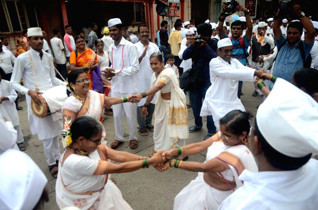 People celebrate Ashadhi Ekadashi in Girgaon of Mumbai, on July 4, 2017.