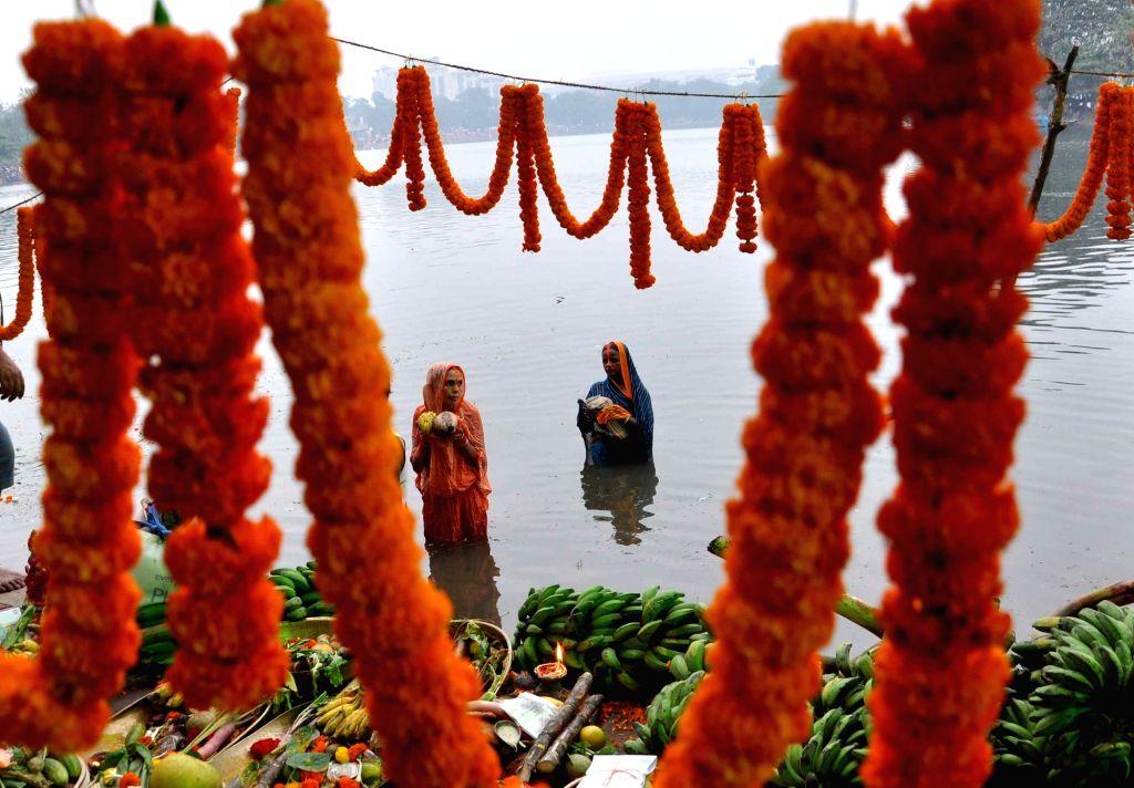 People celebrate Chhath Puja in Kolkata, on Nov 17, 2015.