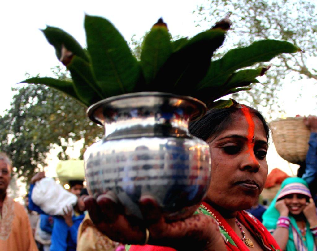 People celebrate Chhath Puja in New Delhi, on Nov 17, 2015.