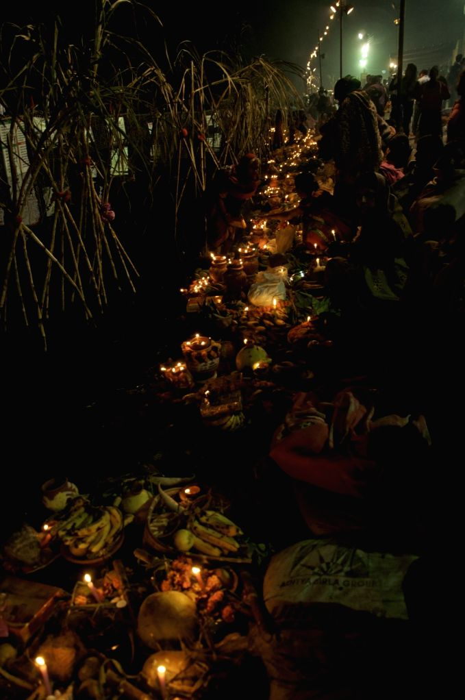 People celebrate Chhath Puja in New Delhi on Nov 18, 2015.