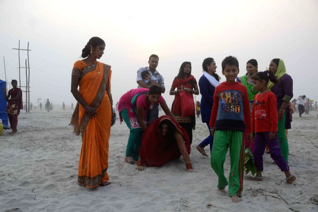 People celebrate Chhath Puja on the banks of Ganga river in Patna, on Nov 17, 2015.