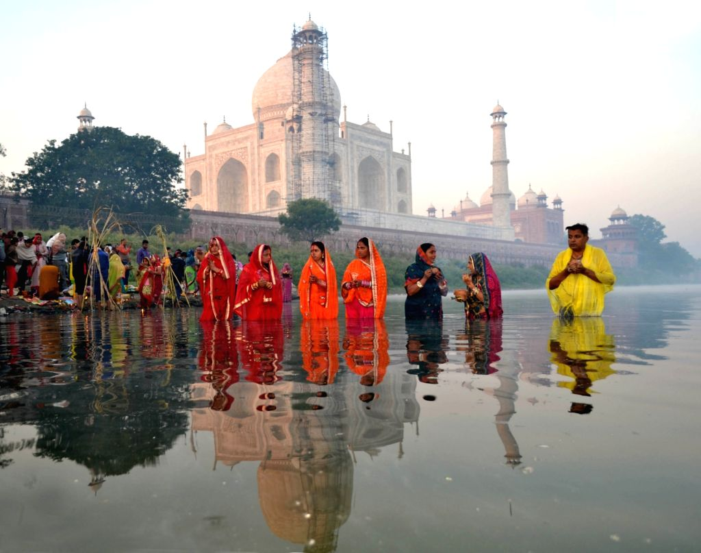 People celebrate Chhath Puja on the banks of Yamuna river in Agra on Nov 18, 2015.