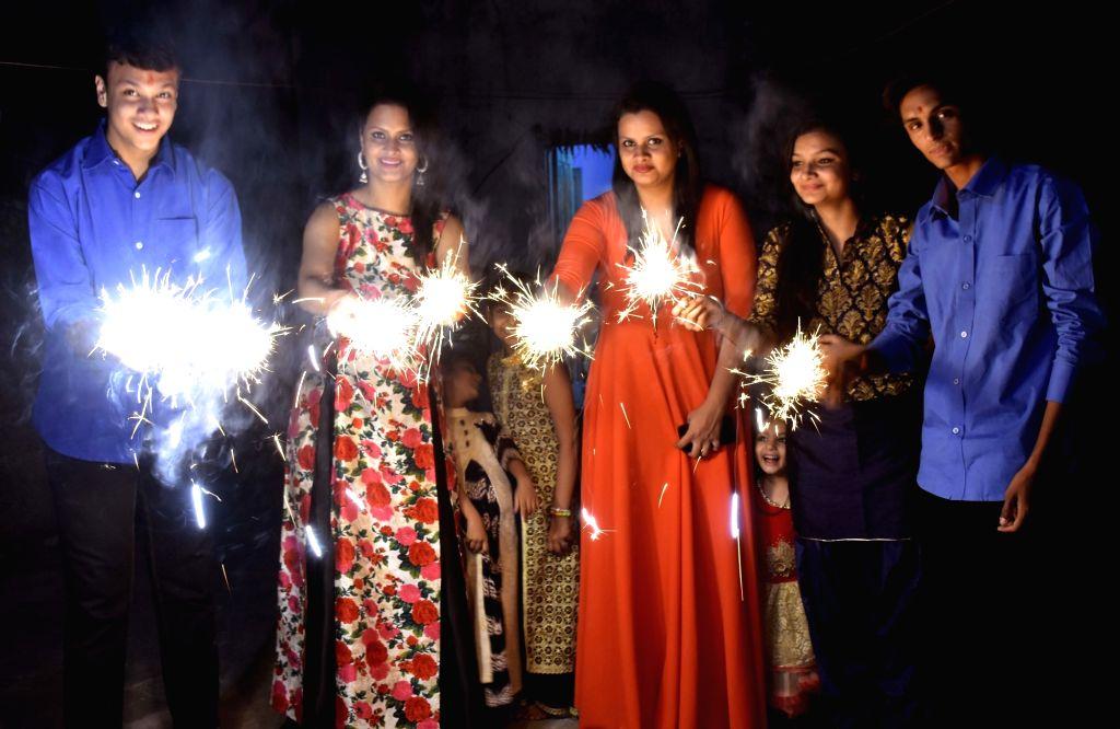 People celebrate Diwali in Jaipur, on Oct 30, 2016.