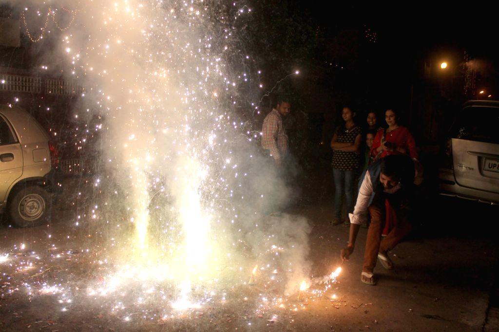 People celebrate Diwali in Mathura on Oct 30, 2016.
