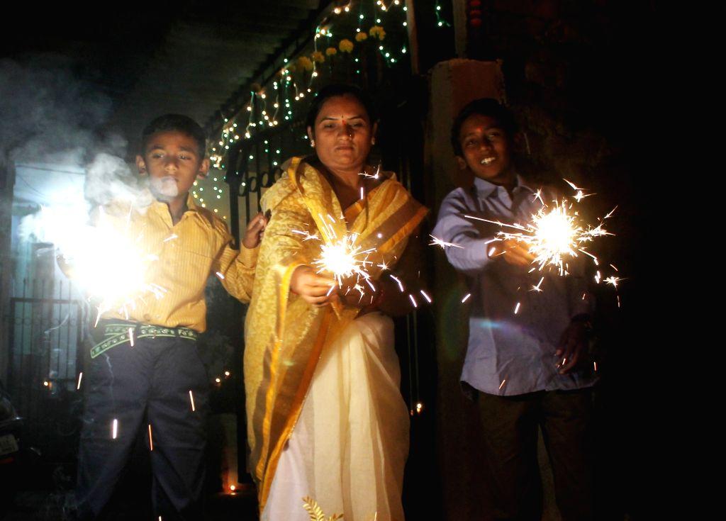 People celebrate Diwali in Nagpur on Oct 30, 2016.