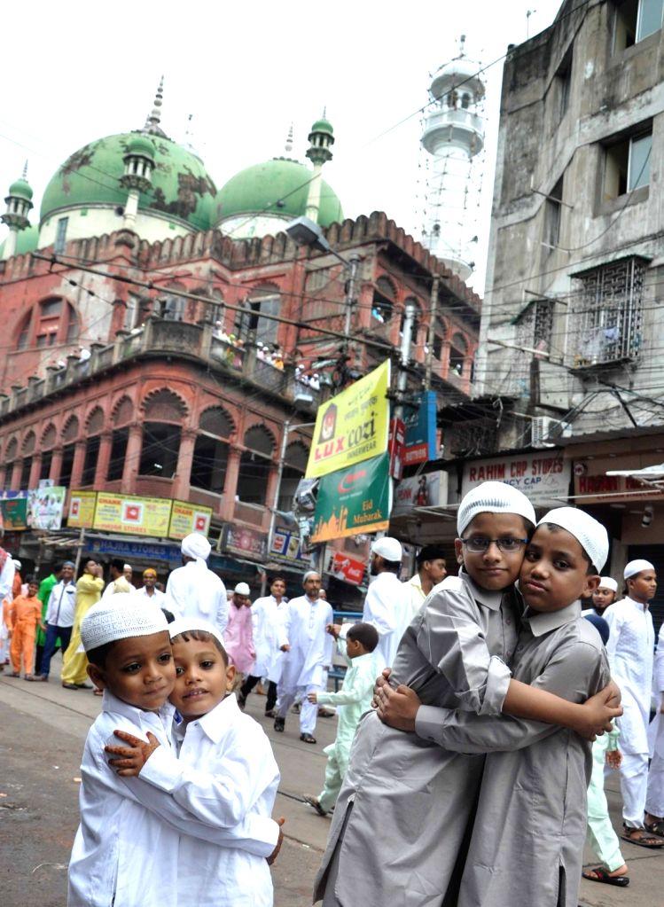 People celebrate  Eid-al-Fitr at Nakhoda Masjid in Kolkata on July 7, 2016.