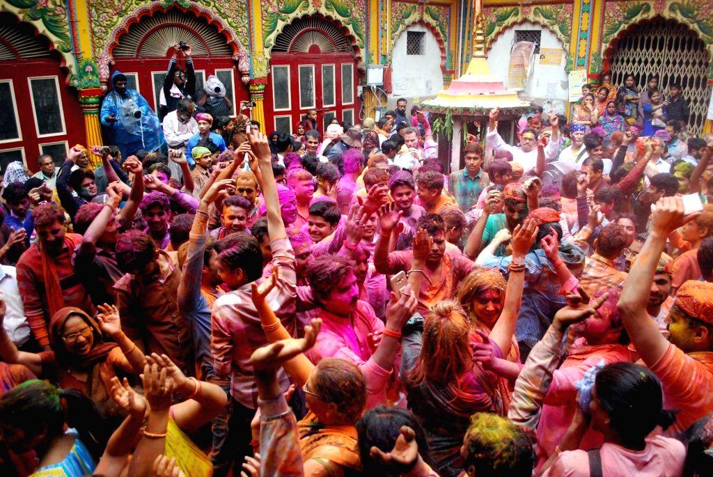 People celebrate Holi at Dwarkadheesh temple in Mathura on March 10, 2017.