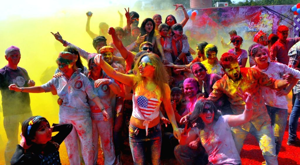 People celebrate Holi in Agra on March 13, 2017.