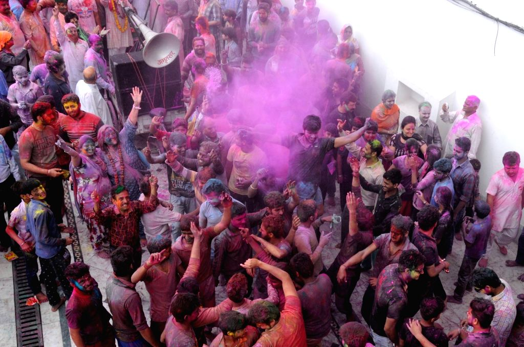People celebrate holi in Amritsar on March 23, 2016.