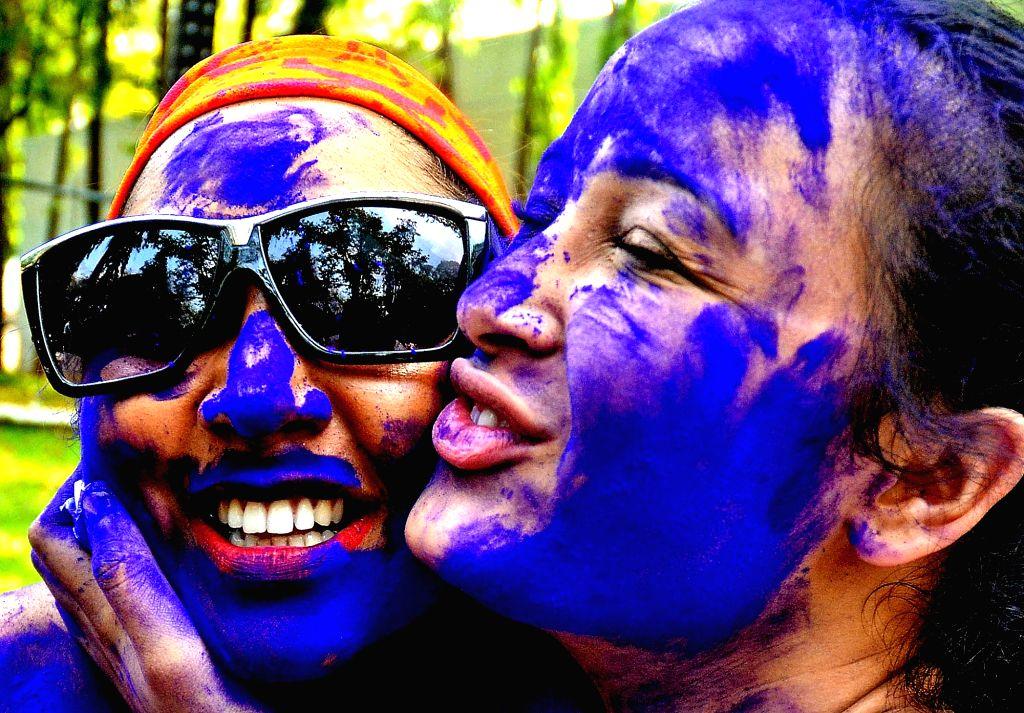 People celebrate Holi in Bengaluru on March 13, 2017.