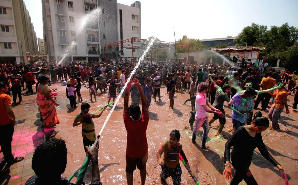 People celebrate Holi in Chennai on March 13, 2017.