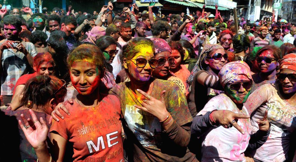 People celebrate Holi in Guwahati on March 13, 2017.