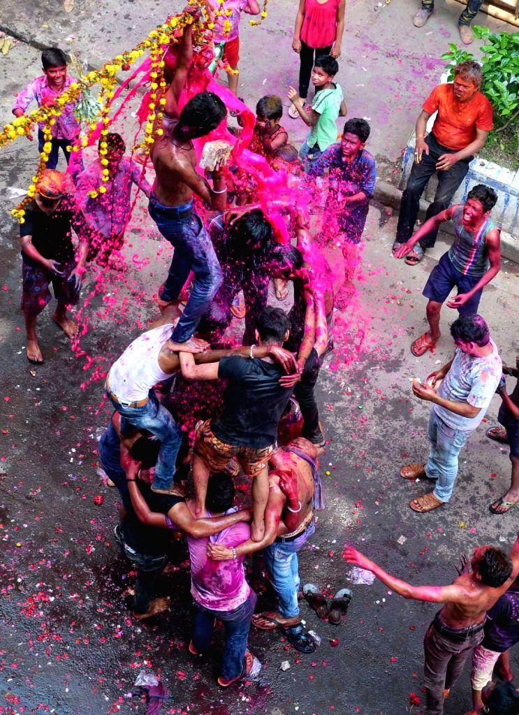 People celebrate Holi in Kolkata on March 13, 2017.