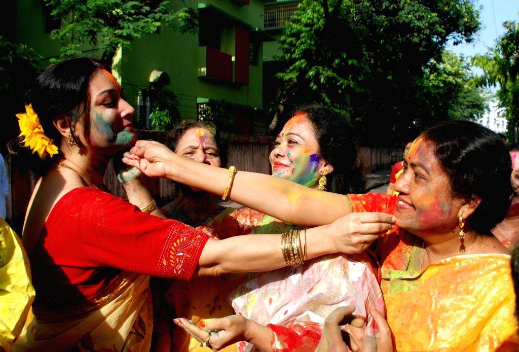 People celebrate Holi in Kolkata, on March 23, 2016.