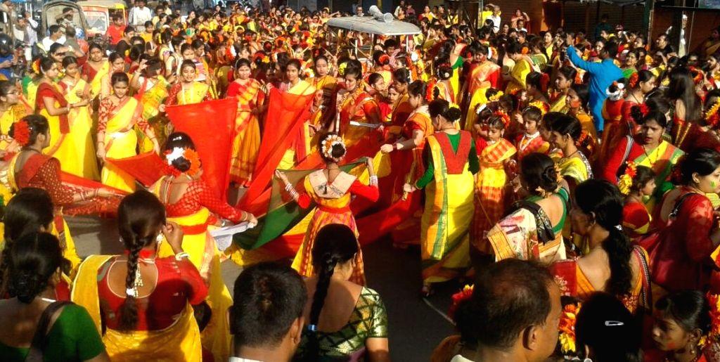 People celebrate holi in Malda, on March 23, 2016.