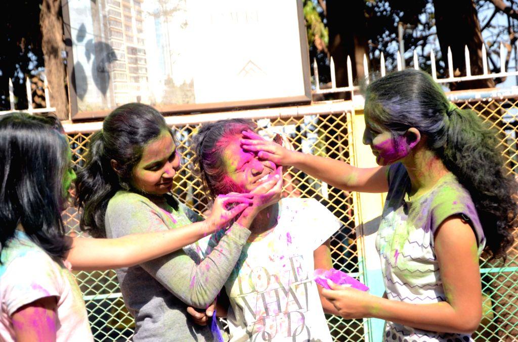 People celebrate Holi in Mumbai on March 13, 2017.