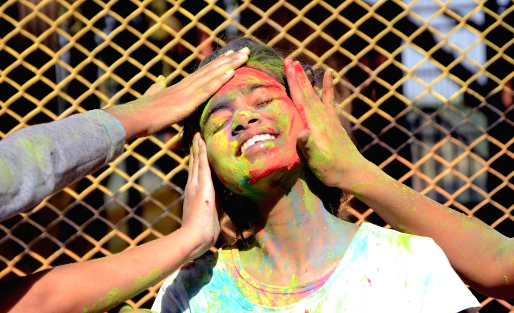 People celebrate Holi in Mumbai on March 13, 2017.