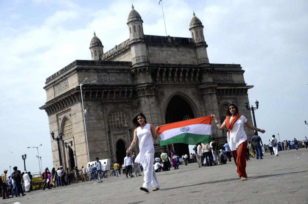 People celebrate Independence Day in Mumbai on August 15, 2013. (Photo::: Sandeep Mahankal/IANS)