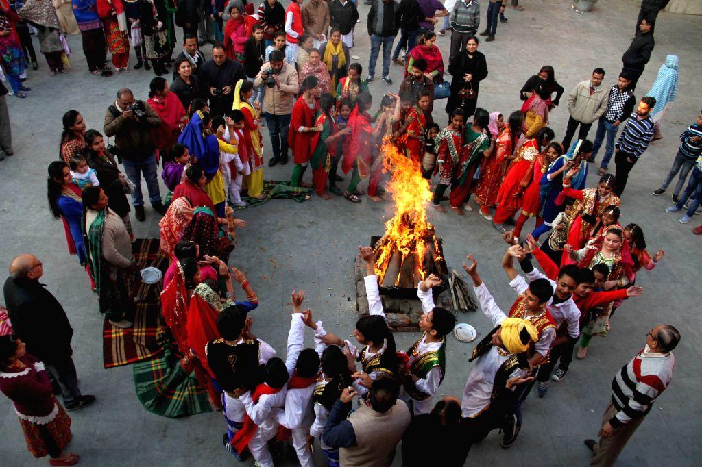 People celebrate Lohri in Jammu on Jan 13, 2017.