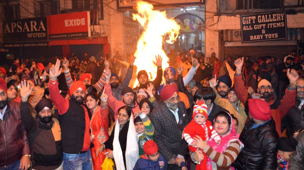 "People celebrate ""Lohri"" in Lucknow on Jan 13, 2017."