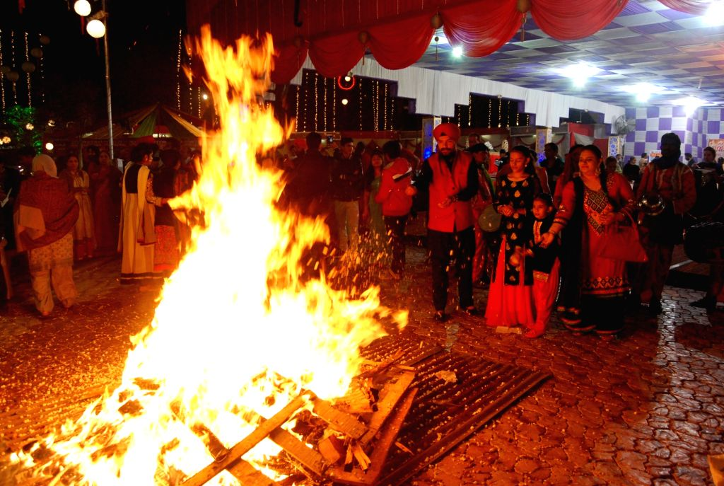 "People celebrate ""Lohri"" in Nagpur on Jan 13, 2017."