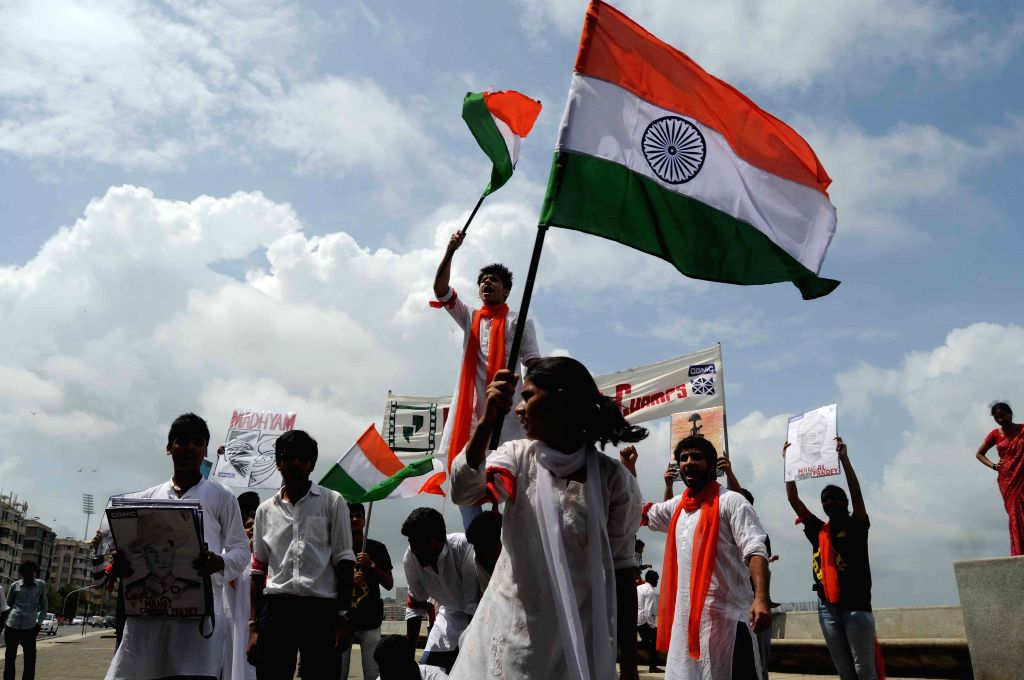 People celebrate on the occasion of 69th ``Independence Day`` in Mumbai, on Aug 15, 2015.