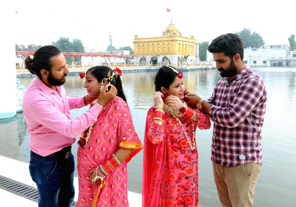 People celebrate 'Teej' at the Golden Temple, in Amritsar on July 22, 2018.