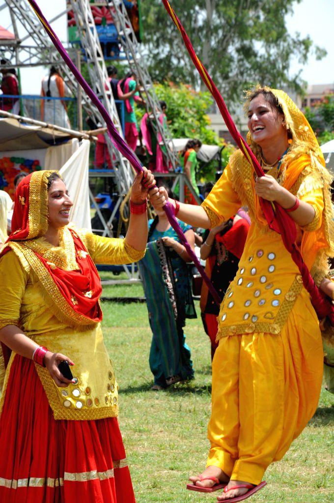 People celebrate Teej festival in Amritsar on Aug 8, 2014.