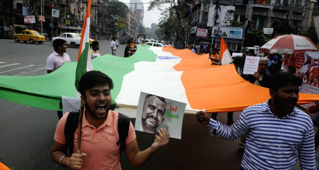 People celebrate the safe return of Indian Air Force (IAF) pilot Abhinandan Varthaman in Kolkata, on March 3, 2019. The 35-year-old Wing Commander was captured on Wednesday by Pakistan after ...
