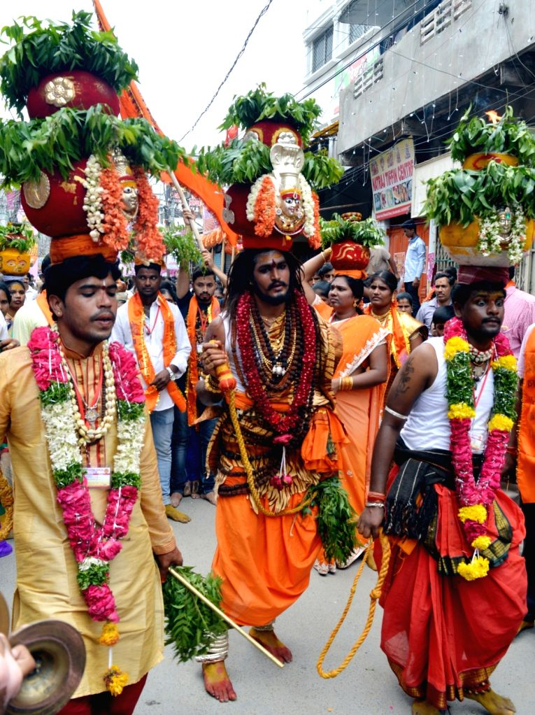 People celebrate Ujjaini Mahankali Bonalu festival in Hyderabad, on July 9, 2017.