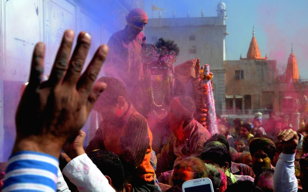 People celebrating Holi at Durgiana temple in Amritsar on March 12, 2017.