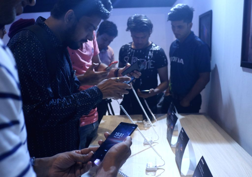 People check out the features of newly launched Nokia 6, 7 Plus and 8 Sirocco smartphones during a launch programme in New Delhi on April 4, 2018.