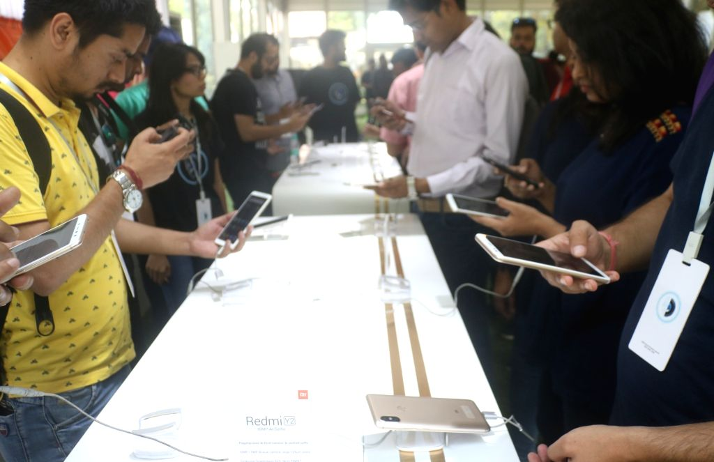 People check out the features of the newly launched Xiaomi Redmi Y2 smartphone, in New Delhi on June 7, 2018.