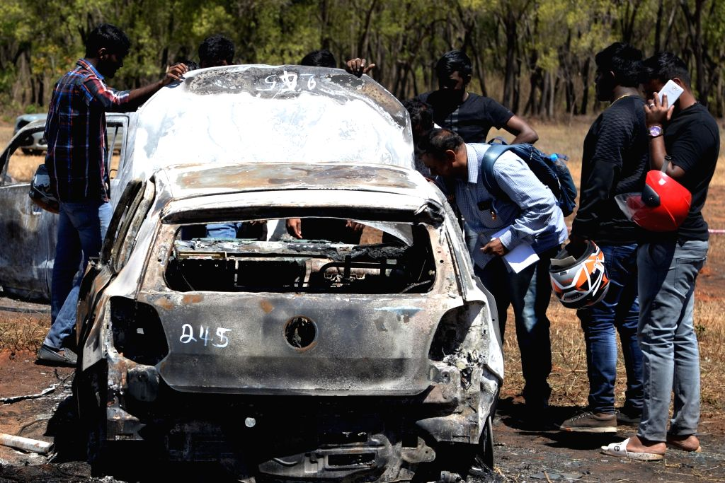 People check out their car after a fire broke out at the parking lot in front of Yelahanka Air Force Station gutting 300 cars, in Bengaluru, on Feb 24, 2019.