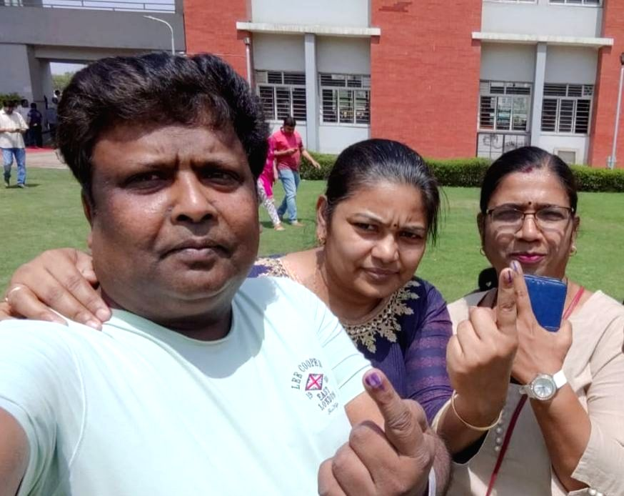 People click pictures after casting their vote at a polling booth in Ghaziabad, Uttar Pradesh during the first phase of seven phased 2019 Lok Sabha polls on April 11, 2019.